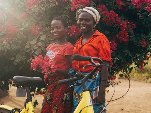 Secondary student Vanessa and her mother, with Vanessa's new bicycle