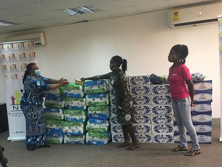 CAMFED Association member Angela Menyah donates soap and cleaning products to the NCCE in Ghana.