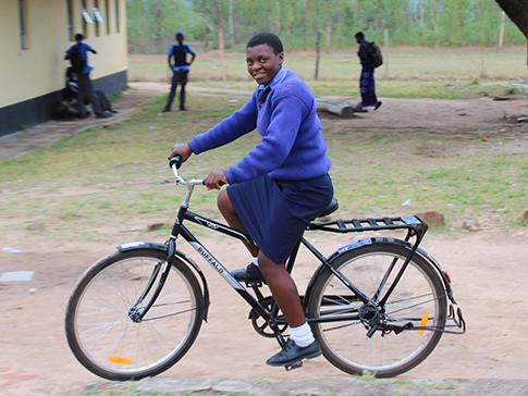 Aneni, a CAMFED scholar in Zimbabwe, on her new bike.