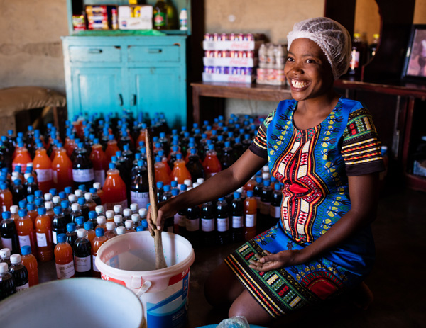 Camfed alumna Lindiwe produces 2,000 two-litre bottles of juice a month