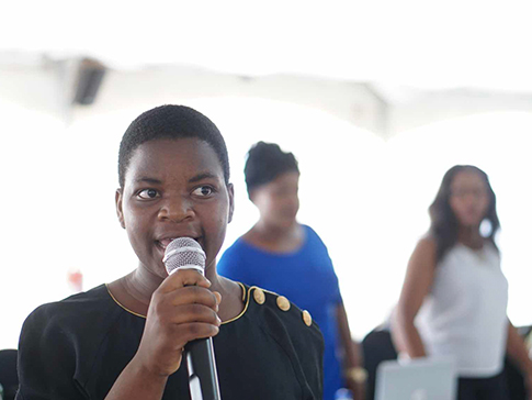 Eliza Chikoti with microphone