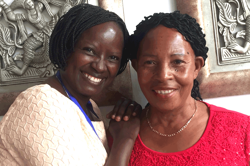 Lydia Wilbard with Anna Bituro, a nurse and one of Camfed Tanzania's first district partners