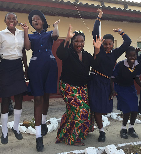 News_feature_-_Angeline_and_Secondary_Scholars_jumping_ZIM_Nick_Kristof_HIP_Update