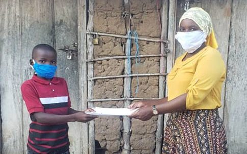 News_feature_-_Education_Day_Eva_donating_learning_materials