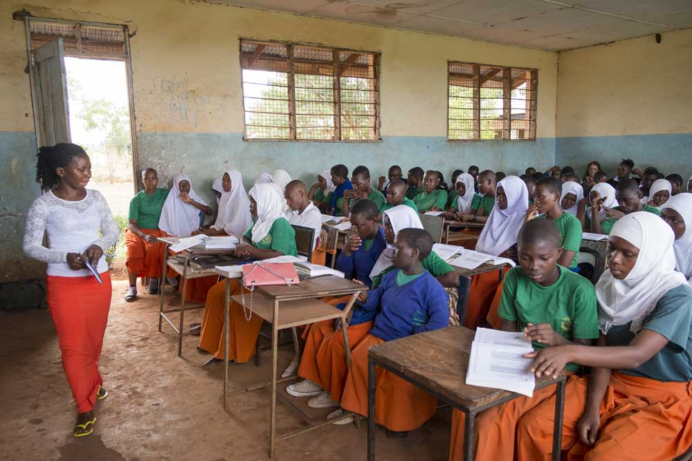 Learner Guide Shani speaks to a class at secondary school in Bagamoyo, Tanzania