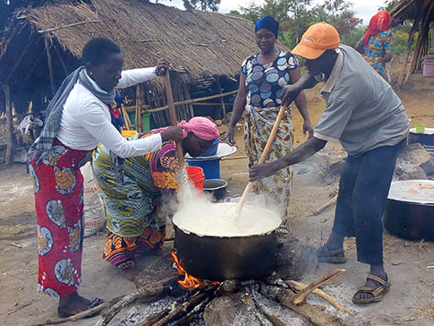 Aida Kalolo cooking with a Parent Support Group