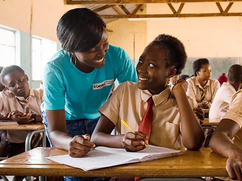 CAMFED Learner Guide Alice delivering a mentoring session.