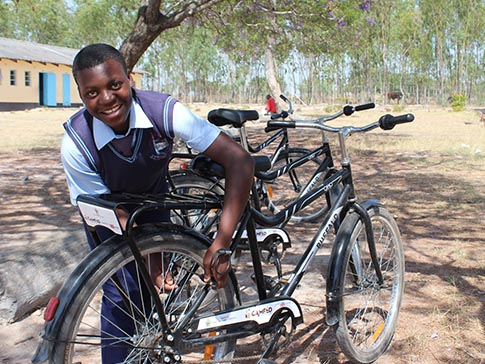 Aneni is proud of her new bike.