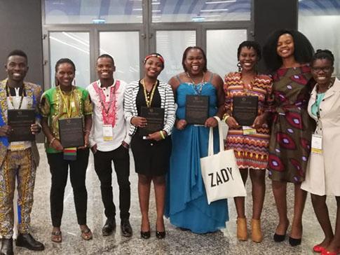 Esnath (in blue dress) at the 2019 Baobab Summit