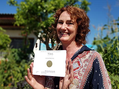 Garden designer Jilayne Rickards with the Gold medal award.