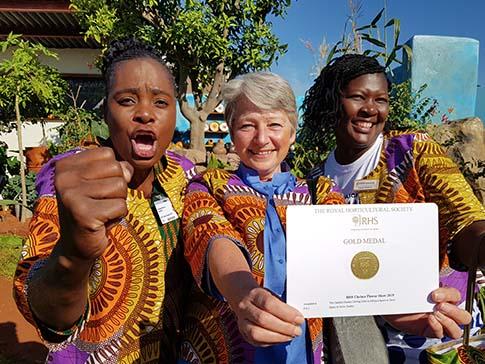Sinikiwe Makove, Miranda Curtis and Clarah Zinyama on the CAMFED Garden.