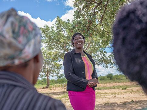 Clarah and community members in rural Zimbabwe