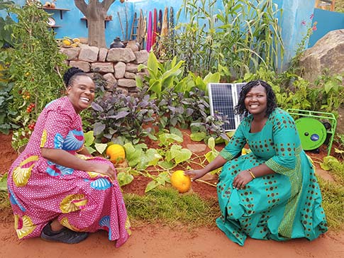 Sinikiwe and Clarah in the CAMFED Garden at the Chelsea Flower Show