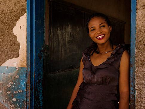 Mwamba pictured outside a school in rural Zambia