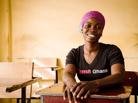 Nimatu in a school classroom where she mentors girls