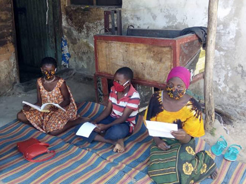 Learner Guide Jamila (right) visits students at home