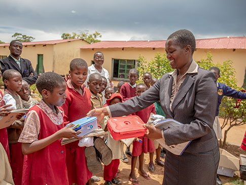 Lucia distributing essentials to vulnerable students