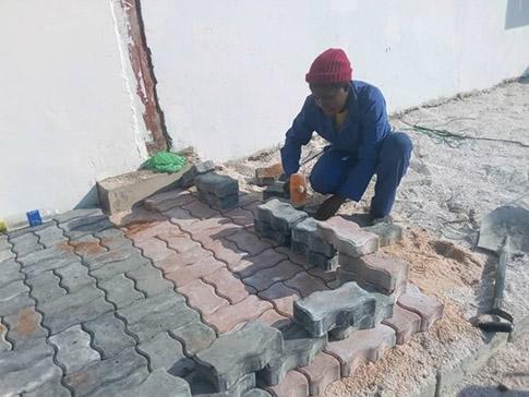 Misozi laying bricks