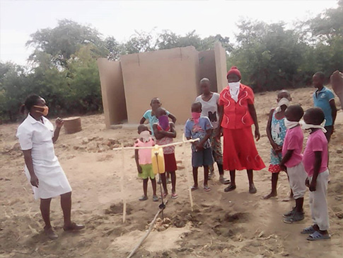 Ottilia providing important health information to her community