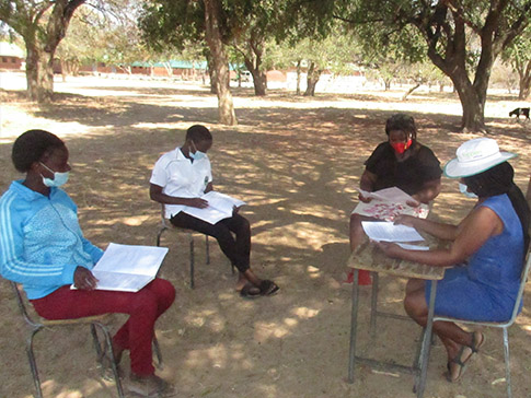 Young women learning in distanced groups in rural Africa