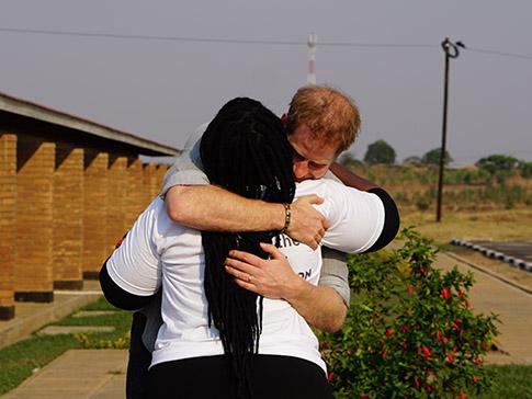 The Duke of Sussex hugs Angie Murimirwa
