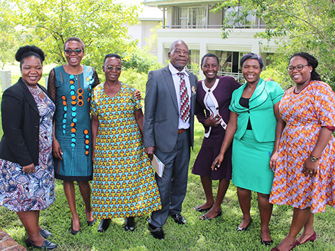 Faith (second from left) with CAMFED Association and community leaders.