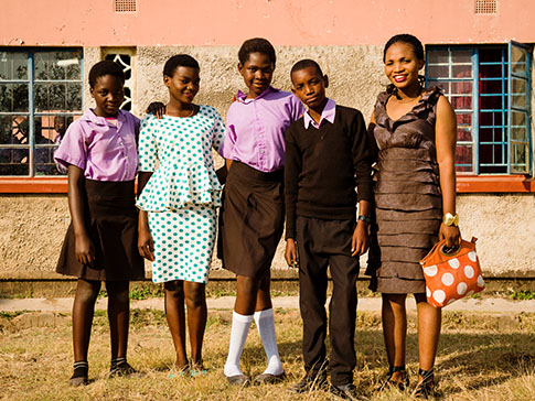 CAMA Member Mwamba with four children she supports at school.