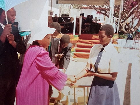 Lucia receives a prize at secondary school