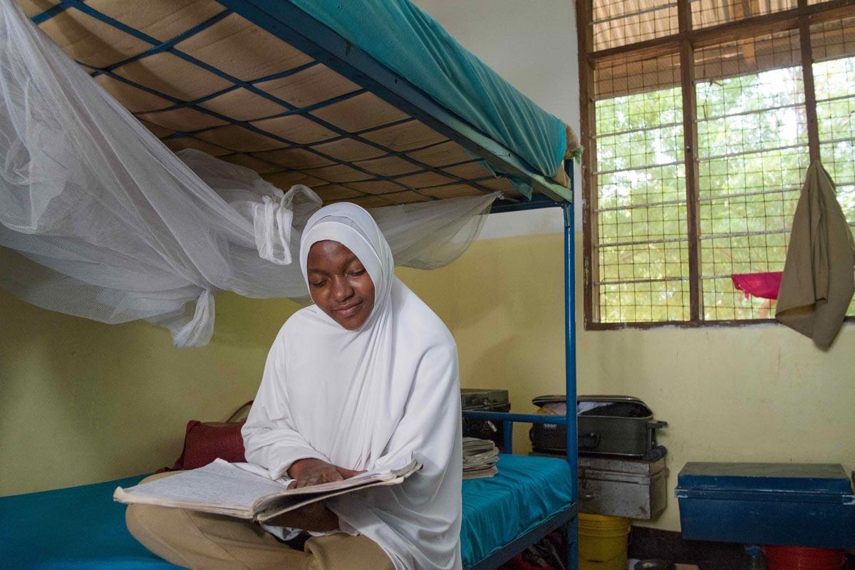 Sharifa studying in her school dorm in Tanzania