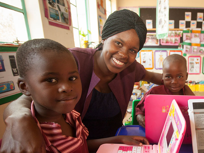 CAMA member & teacher Sazini with young learners