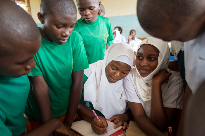 Tanzanian students supported by a Camfed alumna Learner Guide