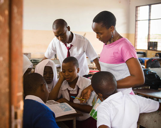 Students in a Camfed partner school running the Learner Guide Program in Tanzania.