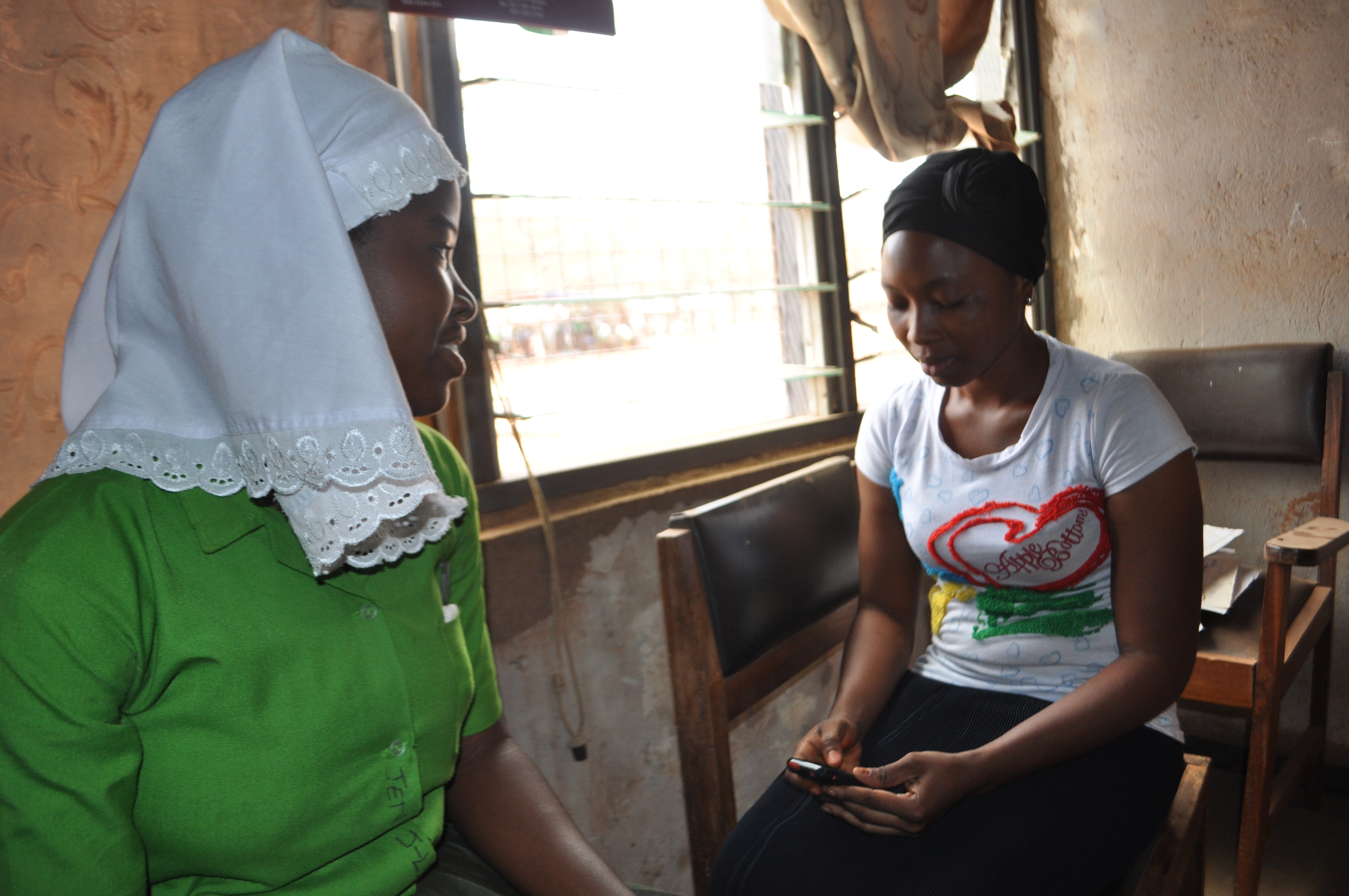 Zubaida, a Camfed trained enumerator, is collecting data for verification in Sagnarigu district in Ghana