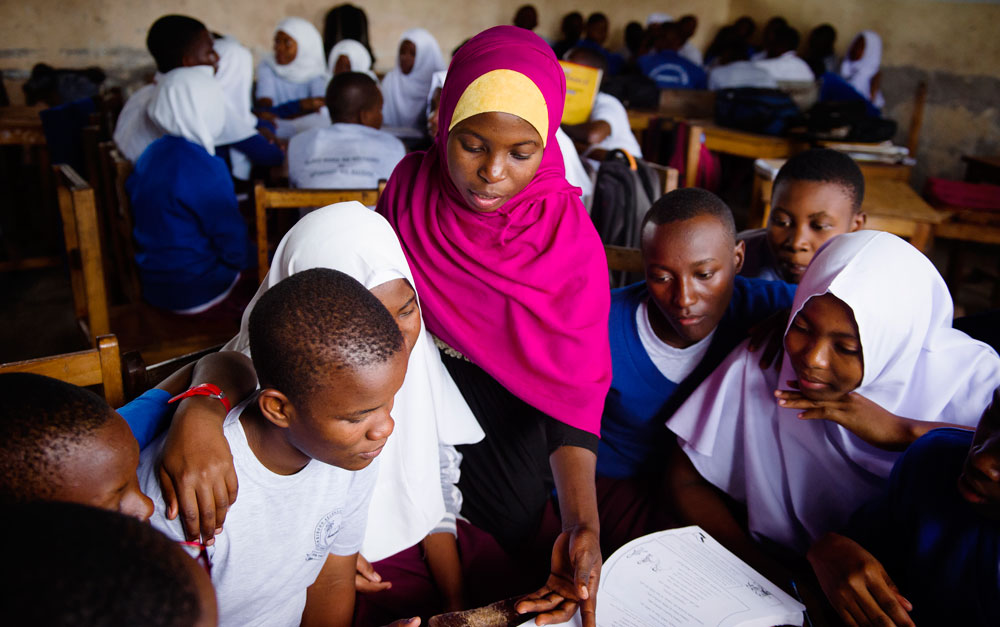 Zuhura supporting her students with the My Better World life skills curriculum