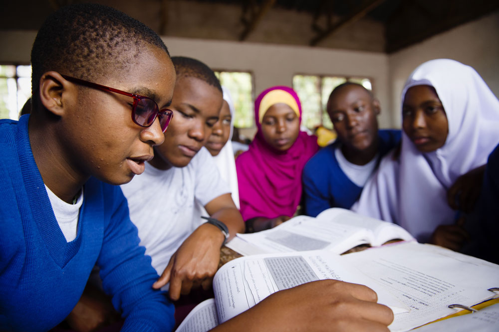 Students in Tanzania working collaboratively on the Camfed life skills curriculum
