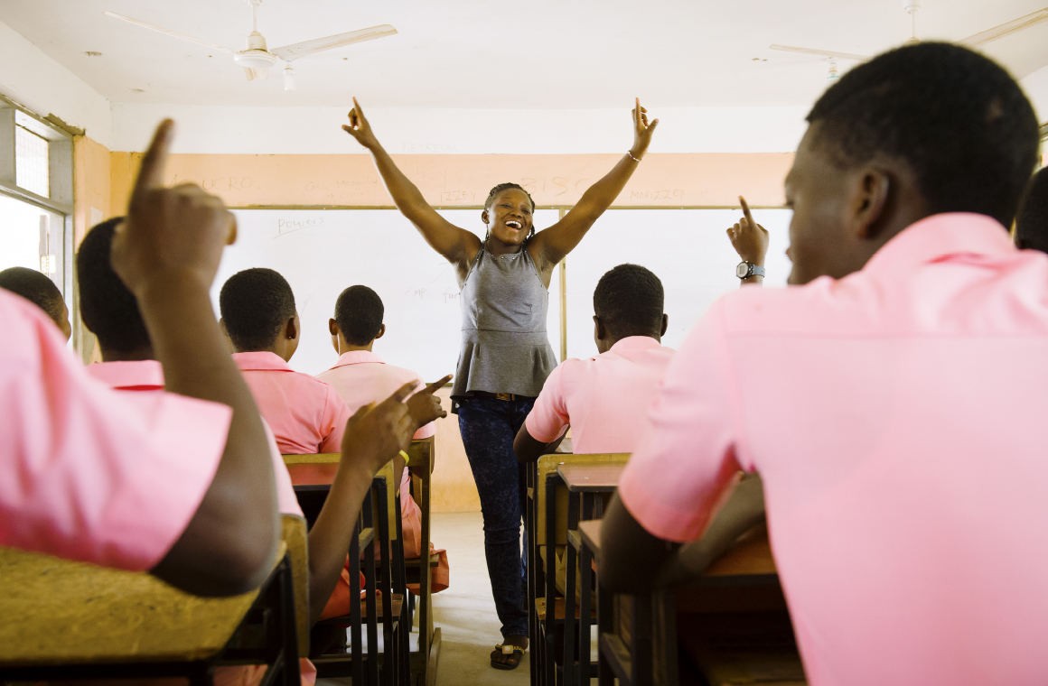 Mercy, a CAMFED Association member in Ghana, leading a life skills and wellbeing session for secondary students