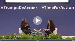 Esnath and Catherine on stage at COP25