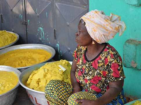 A member of a women's cooperative selling shea butter produced in northern Ghana